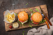 Two tasty grilled classic beef burgers with French fries