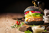 Tasty grilled classic beef black burger with lettuce and mayonnaise sauce
