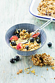 Homemade granola with turmeric, berries and milk