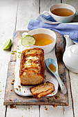 An apple loaf cake with honey served with tea