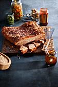 Crispy fried pork belly, sliced on a wooden board