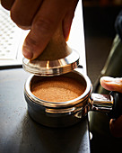 Process of coffee tamping