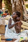 Mother and baby outside a hospital