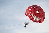 Tourists parasailing