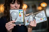 Woman holding LED bulbs