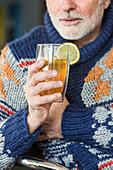 Man drinking grog