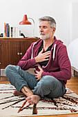 Man practicing respiratory exercises