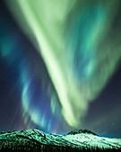 Aurora over mountains in Alaska