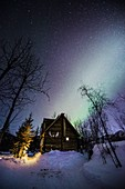 Alaskan homestead under the Aurora