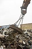 Electromagnet in scrap metal yard