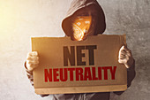 Hooded activist with Net neutrality protest sign