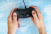 Gamer using video game controller