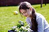 Girl examining plant