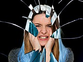 Woman with broken glass around face
