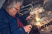 Man using metal grinder