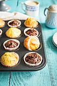 Vanilla and chocolate simple muffins in a baking tray
