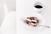 A slice of tiramisu cake and an espresso