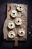 Vegan yufka bagels topped with almonds, goji berries and rice syrup