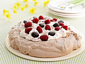 Pavlova with chocolate eggs and raspberries for Easter