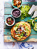 Chicken tostadas with salsa, chicken and salad