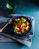 Fish curry with pumpkin, prawns, chilies and coriander