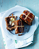 Hot cross buns with icing, chocolate, and raisins