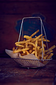 Chips with paper in a frying basket