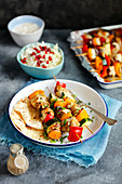 Chicken skewers with vegetabless and home made flatbread