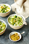 Green vegeatables minestrone with pesto and parmesan