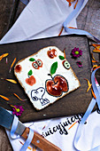 Toast with cream cheese and strawberry jam decorated with Snoopy