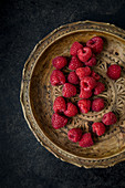Raspberries on a wooden plate