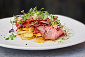 Roast beef with potatoes and cress