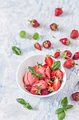 Strawberry ice cream with fresh strawberries and basil