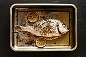 Fried sea bream with lemons