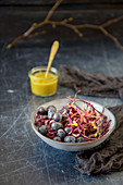 Red cabbage salad with blueberries and an orange-honey-mustard dressing