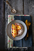 Peach tartlet with flaked almonds and icing sugar