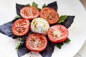 Tomatoes, mozzarella and purple basil