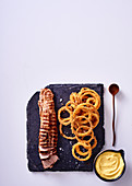Pork fillet with polenta coated onion rings and aioli
