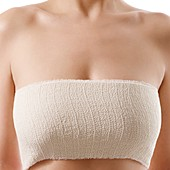Woman's bandaged chest