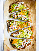 Rustic pizza with courgette cream, courgette flowers and bacon