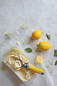 Lemon and elderflower ice cream with an ice cream scoop