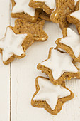 Star-shaped cinnamon biscuits on a wooden surface