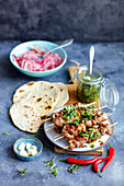 Beef skewers with flatbread, gremolata and pickled onion
