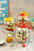 Layered salad in a jar: buckwheat, bean, avo, vegs, quark or feta