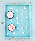 Saint Valentine's holiday greeting set - hot chocolate and heart shaped marshmallows in old enamel mugs