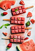 Strawberry watermelon ice cream popsicles with mint