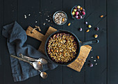 Healthy breakfast - Oat granola crumble with frozen fresh berries, and seeds