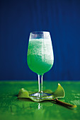 Caribbean Green Poison with orange juice, vodka and peppermint liqueur