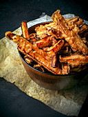 Sweet potato chips in a wooden bowl