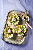 Scallops served with glasswort served in gilded shells